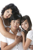 Smiling asian mother with her two daughters — Stock Photo