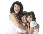 Laughing asian mother with her two daughters — Stock Photo