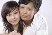Asian mother and her teenage daughter — Stock Photo