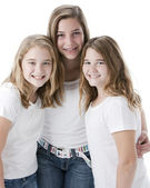 Waist up image of three caucasian sisters — Stock Photo