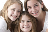 Close up full frame headshot of three caucasian sisters — Stock Photo