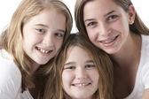 Close up full frame headshot of three caucasian sisters — Stock Photo