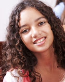 Smiling mixed race little girl — Stock Photo