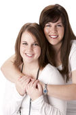 Waist up image of two caucasian adult sisters — Stock Photo