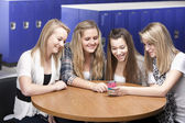 Waist up image of four caucasian teenage high school girls — Stock Photo
