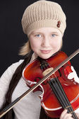 Image of caucasian little girl playing a violin — Stock Photo