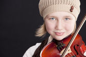 Close up of caucasian little girl playing a violin — Stock Photo