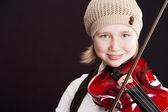 Caucasian little girl playing a violin — Stock Photo