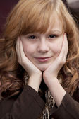 Close up headshot of smiling preteen girl — Stock Photo