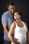 Waist up image of african american man and pregnant woman — Stock Photo