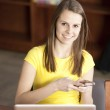 Teenage high school student with a computer and phone — Stock Photo #21370435