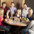 Couples enjoying a night out together at a restaurant bar — Stock Photo