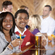 Foto Stock: Young couple relaxing in bar