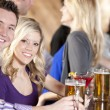 Royalty-Free Stock Photo: Young couple relaxing at bar