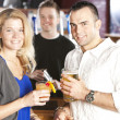 Couple relaxing and enjoying themselves at a bar — Stock Photo