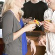 Young couple relaxing and enjoying themselves at a bar — ストック写真