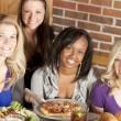 Royalty-Free Stock Photo: Image of a young adult group of women eating at restaurant