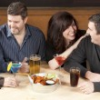 Young adult couples enjoying a night out together at a restaurant bar and grill. — Stock Photo #21370097