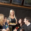 Young adult couples enjoying a night out together at a restaurant bar and grill. — Stock Photo #21370101