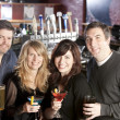 Adult caucasian couples enjoying a night out with friends at a restaurant bar. — Stock Photo #21370123