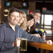 Adult caucasian couples enjoying a night out with friends at a restaurant bar. — Stock Photo #21370133