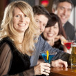 Adult caucasian couples enjoying a night out with friends at a restaurant bar. — Stock Photo