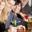 Adult caucasian couples enjoying a night out with friends at a restaurant bar. — Stock Photo #21370137