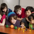 Stock Photo: School Science. Students in the school classroom learning about science and molecules