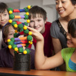 Stock Photo: School Science. Students in the school classroom learning about science and DNA.