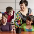 School Science. Students in the school classroom learning about science and DNA. — Stock Photo #21370239