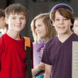 Stockfoto: School Education. Group of middle school age students talking at their lockers during break from class