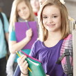 School Education. Group  of middle school age students talking at their lockers during a break from class - Stock Photo
