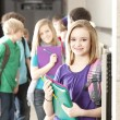 School Education. Group of middle school age students talking at their lockers during a break from class — Stock Photo