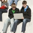 Royalty-Free Stock Photo: Education.  Teenage high school students studying together outside.