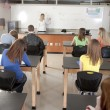 Постер, плакат: School Science Teacher instructing students