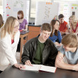 School Science. Teacher helping her students — Stock Photo #21370321