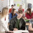 School Science.  Teacher helping her students - Stock Photo