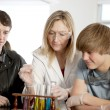 School Science.  Teacher  teaching high school students about chemistry in science class. - Stock Photo