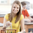 School Science. Caucasian high school student learning about chemistry in science class. — Stock Photo #21370391