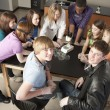 School Science. High school students looking at different specimens in their school  science or biology class — Stock Photo