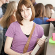 Education.  Teenage  high school student standing at her locker — Stockfoto