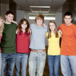 Education.  Group  of teenage high school student friends standing in the hallway — Stock Photo