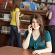 Teenage high school student in the school library — Stock Photo