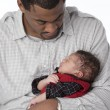 Stock Photo: African american real father holding his newborn baby son