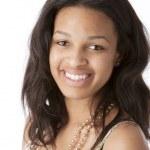 Real. Black smiling teenage girl — Stock Photo