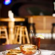 Food and Drink. Lasagna with garlic bread and glass of iced tea - Stock Photo