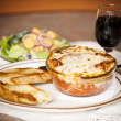 Food and Drink.  Lasagna with garlic bread - Photo