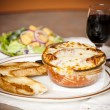 Food and Drink.  Lasagna with garlic bread - Stock Photo