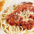 Stock Photo: Food and Drink. Closeup image of hearty spaghetti dinner with garlic bread