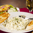 Food and Drink.   Fettucini alfredo dinner with garlic bread, salad and a glass of white wine. — Stock Photo
